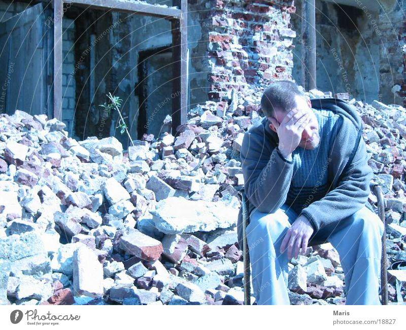 Social housing Building rubble House (Residential Structure) Trash Man Broken Human being Chair Destruction