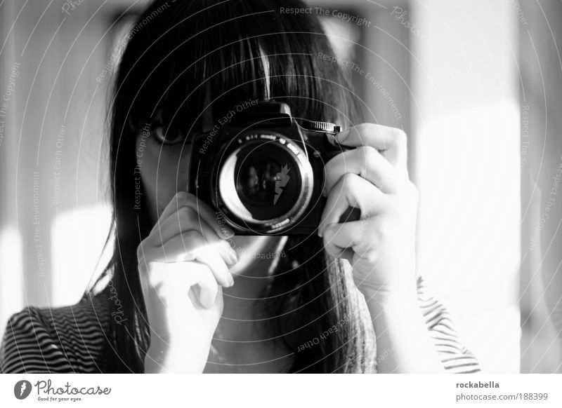 Woman with digital camera Feminine Observe Uniqueness Take a photo Photographer Designer Bangs Operational Looking Objective Camera Hide Mysterious