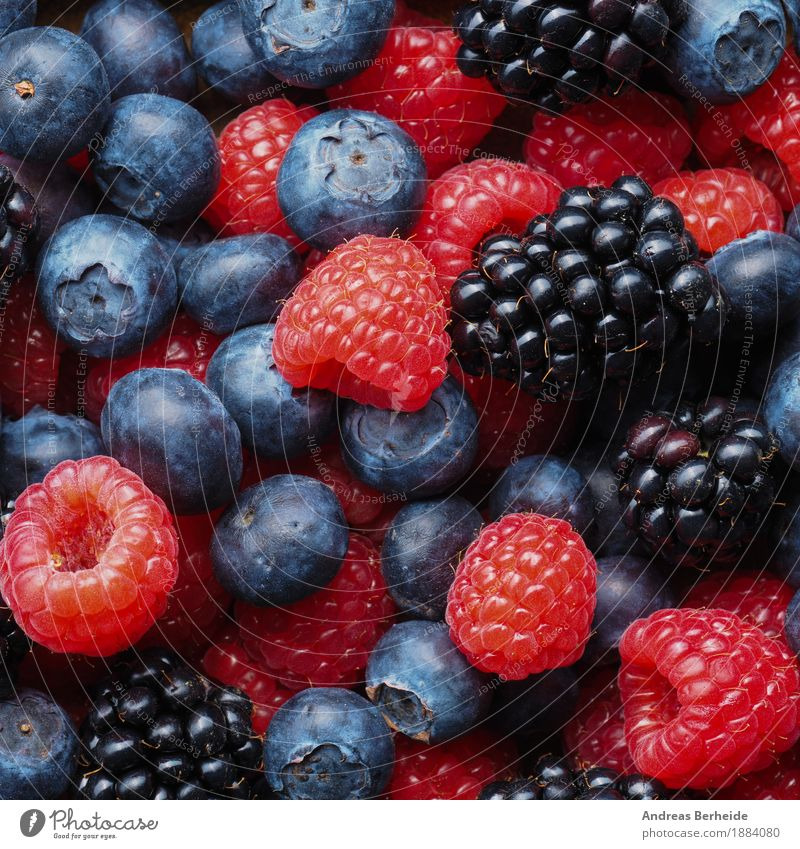 Fresh berries Fruit Vegetarian diet Healthy Eating Delicious Background picture mix red food dark Top assorted raspberries blue blueberries fresh fruits sweet