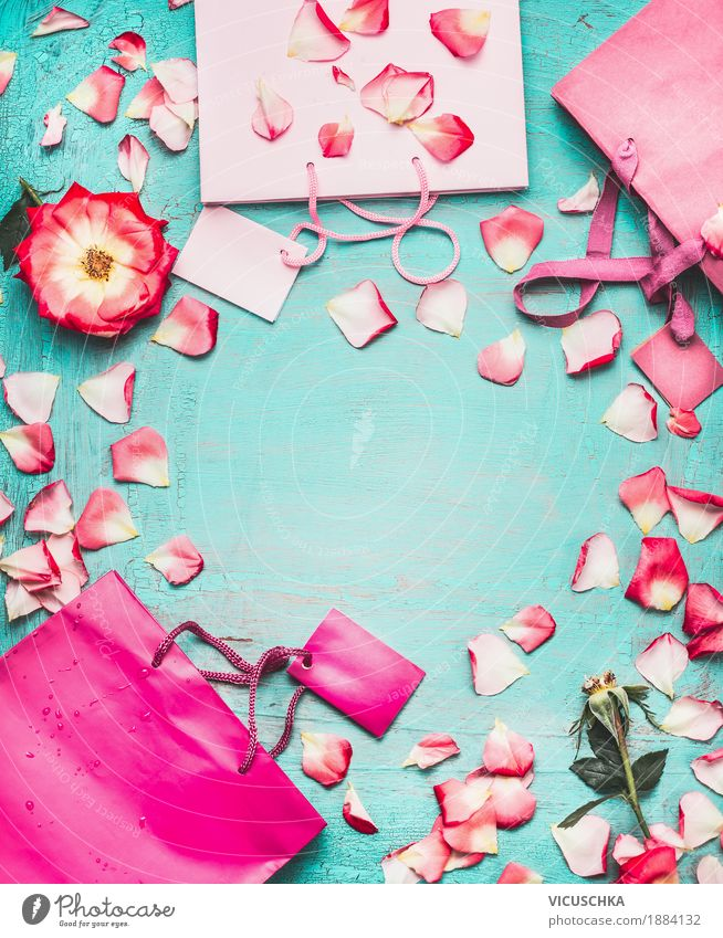 Pink paper carrier bags and flowers on turquoise background Shopping Luxury Style Design Joy Summer Decoration Party Feasts & Celebrations Valentine's Day