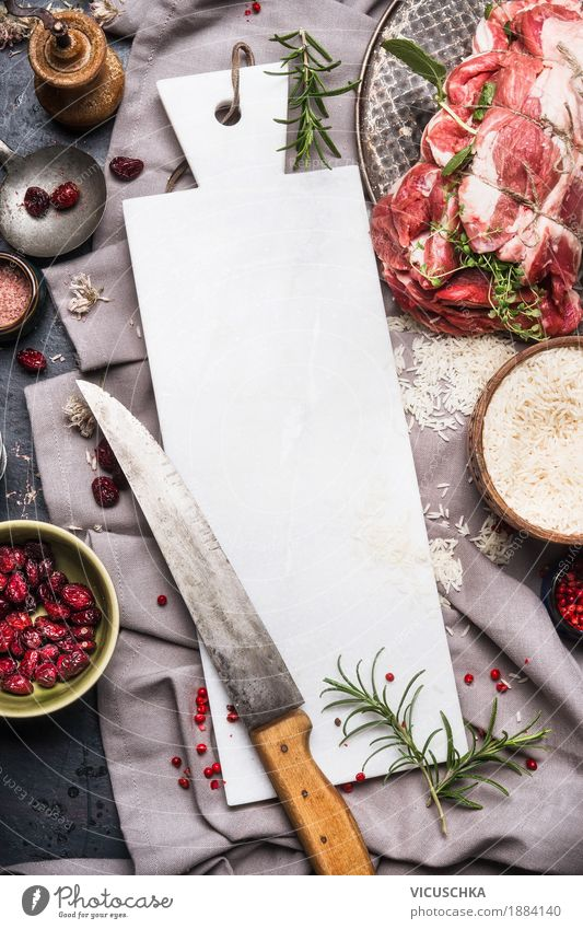 Roast meat preparation with marble chopping board and knife Food Meat Herbs and spices Cooking oil Nutrition Dinner Banquet Organic produce Crockery Knives
