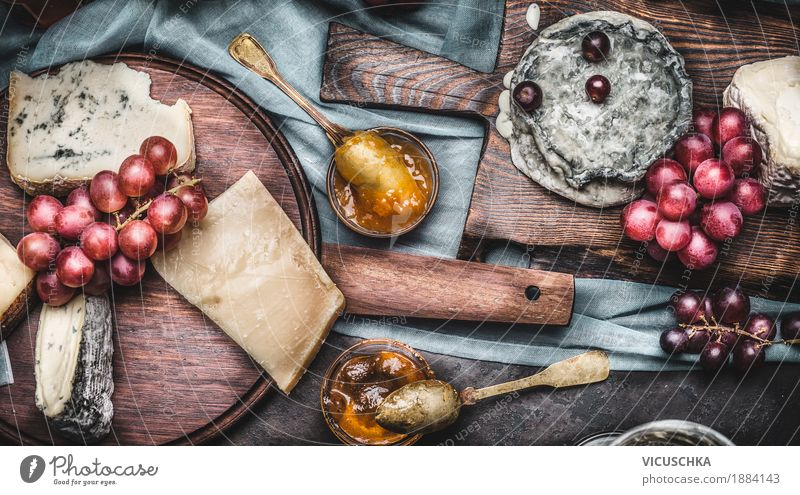 Cheese on cutting boards with grapes and honey Food Fruit Dessert Nutrition Banquet Crockery Style Design Table Yellow Brie Gourmet Snack Selection