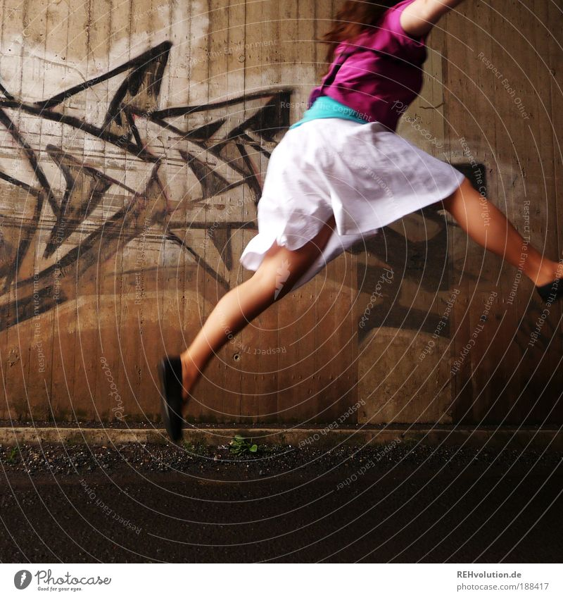 I was thinking about escaping. Feminine Young woman Youth (Young adults) 18 - 30 years Adults Art Wall (barrier) Wall (building) Street Skirt Footwear