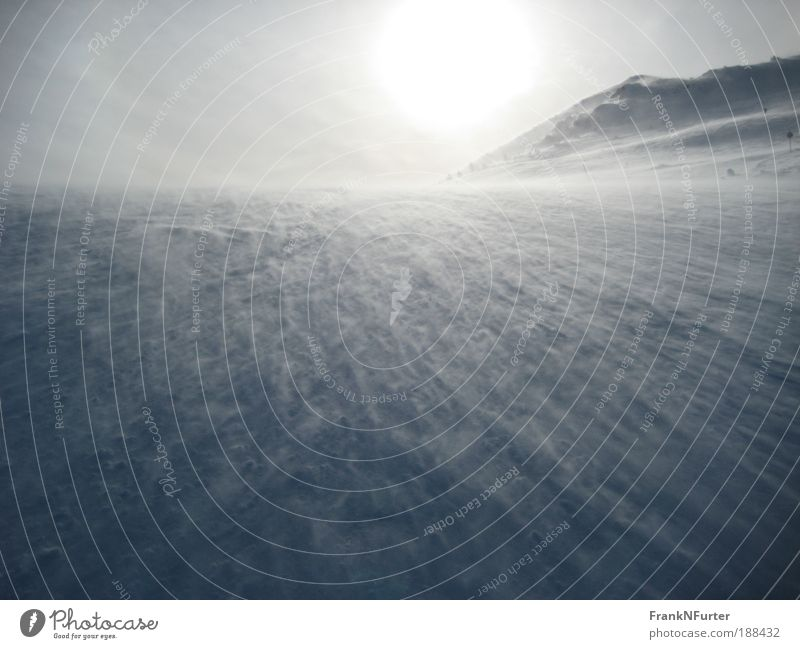 Strange Ocean Environment Nature Landscape Elements Sky Sun Winter Bad weather Wind Gale Ice Frost Snow Alps Mountain Snowcapped peak Dark Natural Blue Silver