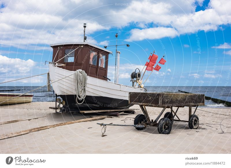 A fishing boat in Koserow on the island of Usedom Relaxation Vacation & Travel Tourism Beach Ocean Nature Landscape Sand Water Clouds Coast Baltic Sea