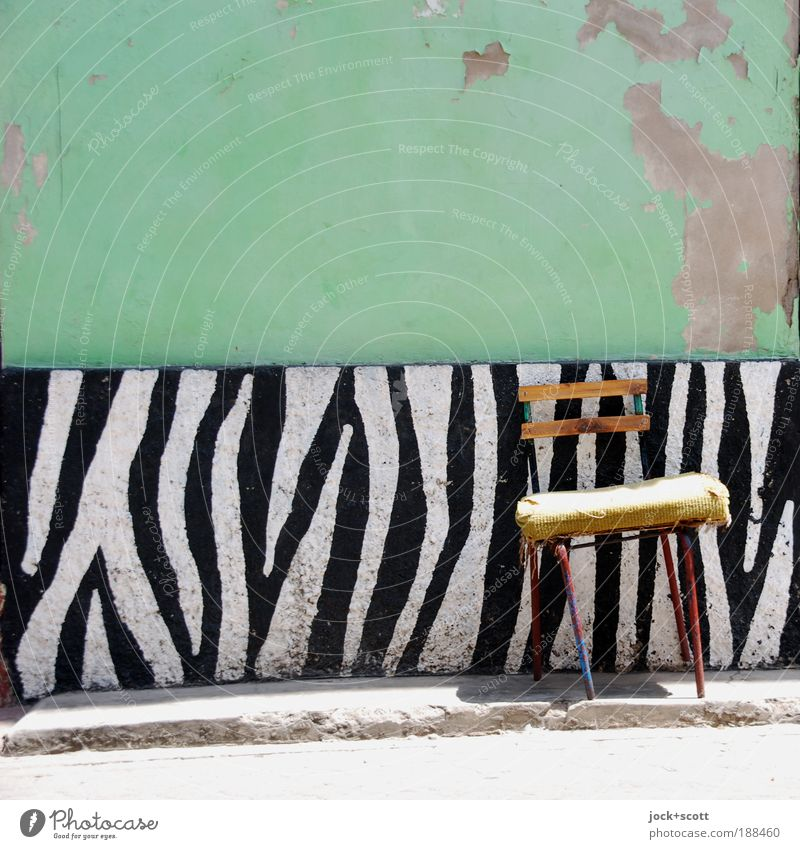 A crosswalk rarely comes alone Street art Old town Wall (building) Chair Exotic Uniqueness Original Serene Design Idyll Improvise Zebra crossing Ravages of time