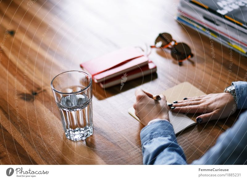 Human being Woman Youth (Young adults) Young woman 18 - 30 years Adults Feminine Paper Write Calendar Desk Sunglasses Wooden table Piece of paper Denim Left