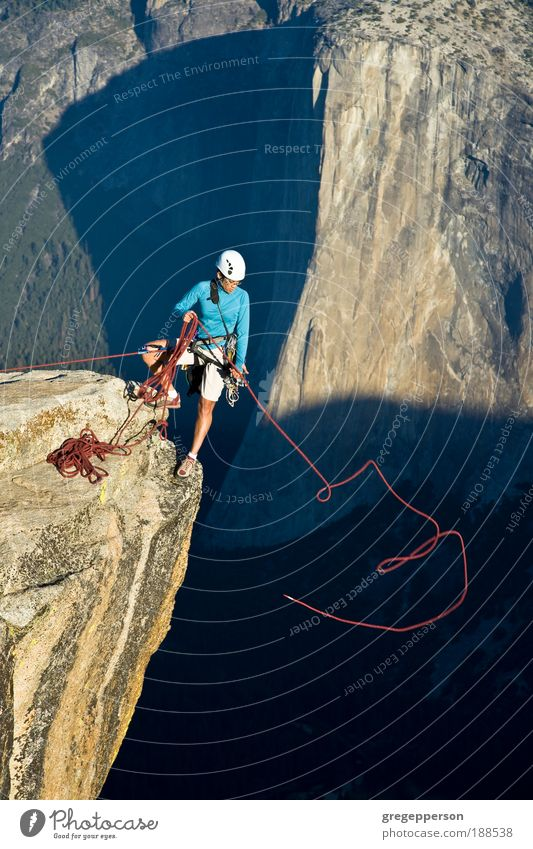 Climber on the summit. Human being Woman Nature Mountain Adults Sports Freedom Rock Fear Action Power Contentment Success Tall Dangerous Fitness