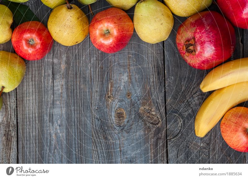 Bananas, pomegranates, apples and pears on a gray wooden surface Red Yellow Eating Autumn Natural Wood Garden Food Gray Above Fruit Nutrition Fresh Vantage point Table Harvest