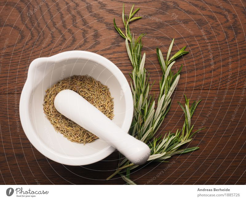 Healthy Eating Herbs and spices Delicious Twig Organic produce Mediterranean Fragrance Wooden table Dried Aromatic Ingredients Spicy Rosemary Mortar