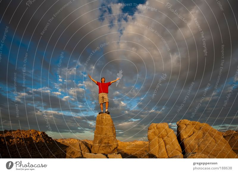 Rock climber on the summit. Human being Sky Nature Man Joy Adults Landscape Mountain Life Freedom Feasts & Celebrations Rock Contentment Tall Hiking Success
