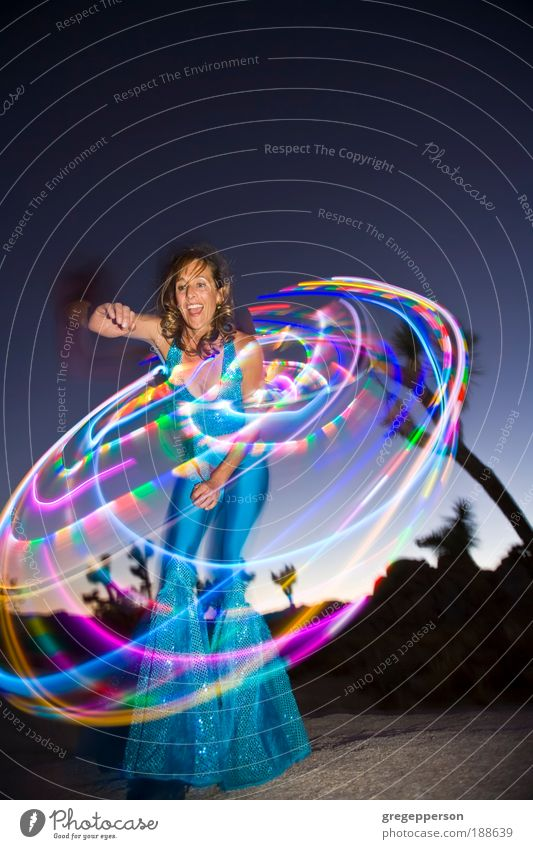 """Hoop dancer performing. Exotic Life Entertainment Dance Feminine Woman Adults 1 Human being 30 - 45 years Dancer Rotate """"color image"""" """"hoop dancing"""" """"hula hoop"""""""