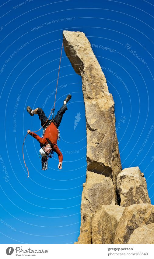 Rock climber falling upside down. Human being Man Adults Mountain Tall Adventure Dangerous Fear Perspective Footwear Climbing To fall Trust Protection Action
