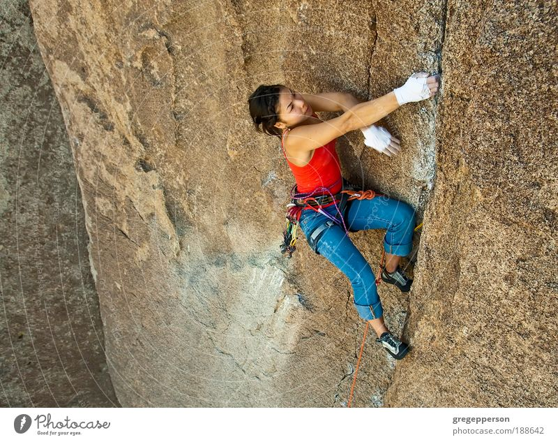 Female rock climber. Adventure Expedition Climbing Mountaineering Rope Young woman Youth (Young adults) 1 Human being 18 - 30 years Adults Athletic Tall Success