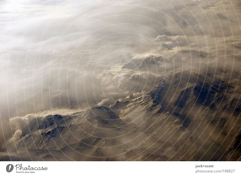 High flyer alpine country Landscape Earth Sky Clouds Winter Alps Mountain Peak Far-off places Nature Bird's-eye view Aerial photograph Abstract Shadow