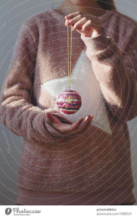 Young girl enjoying her handmade colorful Christmas ball Human being Child Youth (Young adults) Christmas & Advent Girl Lifestyle Feasts & Celebrations Decoration Infancy 8 - 13 years Tradition Home Sweater Anonymous Hold Ornament