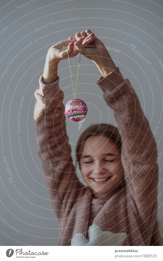 Young girl enjoying her handmade Christmas ball Lifestyle Joy Happy Decoration Feasts & Celebrations Christmas & Advent Human being Girl Youth (Young adults) 1