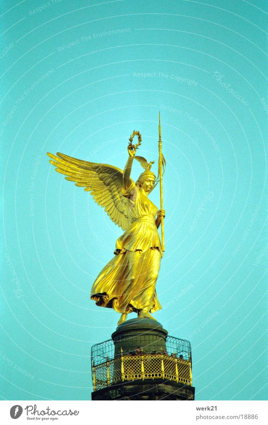 Victory column in Berlin Landmark War Statue Monument Historic Sky Angel Gold Victoria laurel wreath field signs