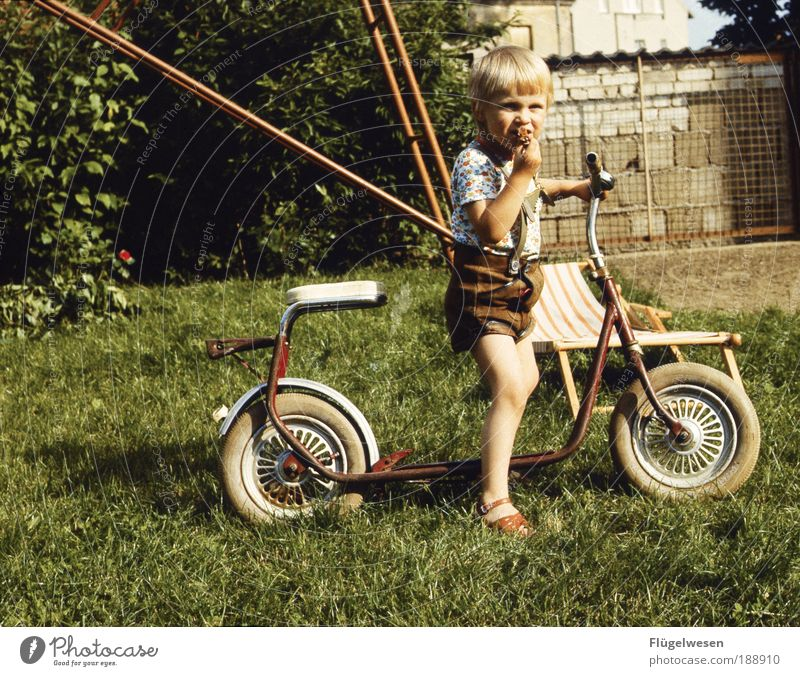 Meadow Playing Boy (child) Wall (barrier) Ice Power Blonde Leisure and hobbies Motorcycle Cool (slang) Child Climbing To enjoy GDR Swing Parenting