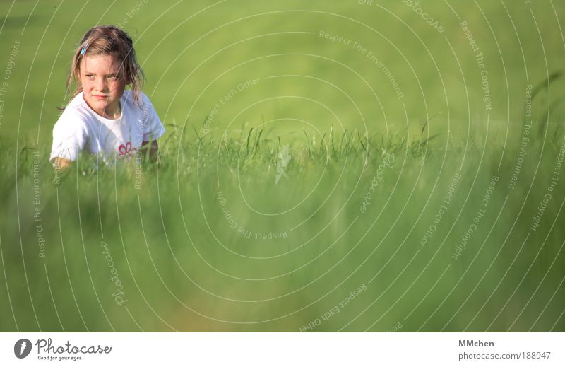green Meadow Child Girl Green Skeptical Expectation Hope Wait Observe Hiding place Hide disguised Camouflage
