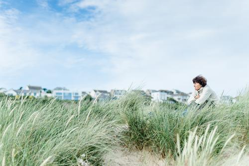 fresh breeze Harmonious Well-being Contentment Relaxation Calm Leisure and hobbies Vacation & Travel Freedom Summer vacation Beach Dune Marram grass Human being