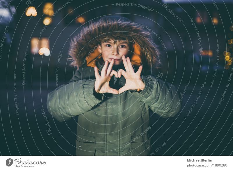 Boy shows heart with hands, in winter clothes in urban environment Winter Child Human being Masculine Infancy Fingers 1 3 - 8 years Love Heart Sign