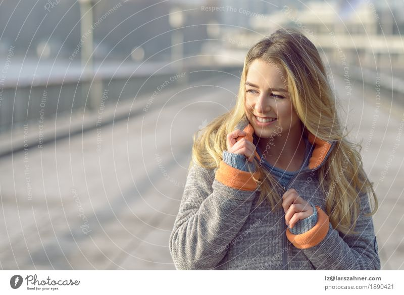 Happy woman with a lovely smile Lifestyle Joy Face Freedom Sun Winter Woman Adults 1 Human being 18 - 30 years Youth (Young adults) Nature Autumn Wind Town