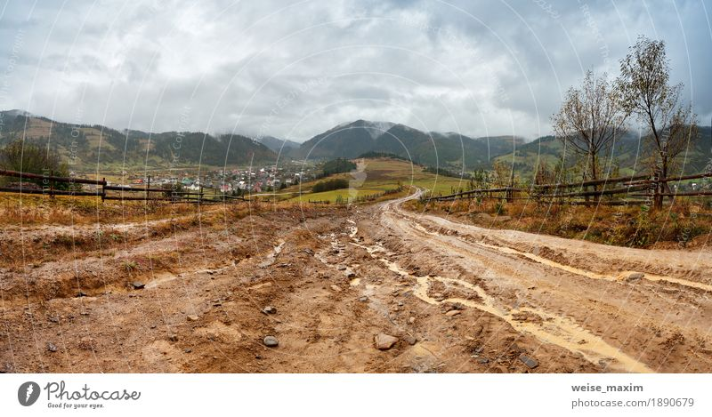 Muddy ground after rain in mountains. Extreme path Sky Nature Vacation & Travel Landscape Red Clouds House (Residential Structure) Far-off places Mountain Street Yellow Lanes & trails Autumn Freedom Gray Tourism