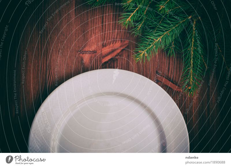 Half of an empty white plate on brown wooden surface Old Christmas & Advent White Tree Winter Dish Snow Wood Feasts & Celebrations Brown Above Decoration