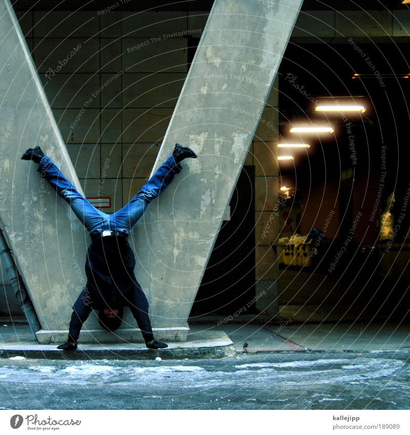 Man Adults Wall (building) Wall (barrier) Jeans Human being Jacket Entrance Column Tunnel Hero Sportsperson Gymnastics Complex Full-length Guard