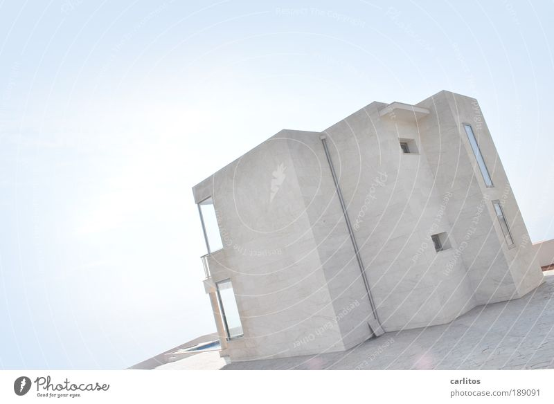 tilted position Detached house Dream house Build Illuminate Esthetic Exceptional Sharp-edged Simple Uniqueness Cold Rich Blue White Safety (feeling of)