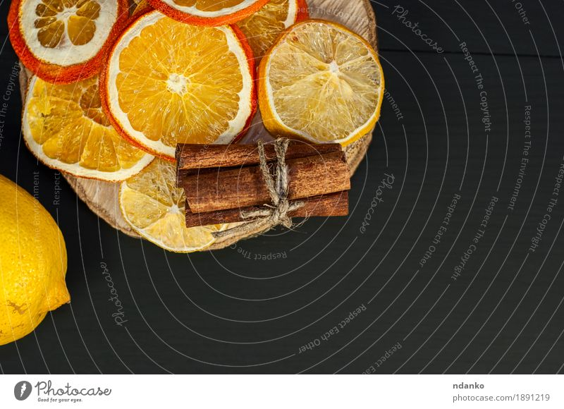 Citrus and cinnamon on the black wooden background Black Yellow Eating Natural Wood Food Above Fruit Decoration Fresh Orange Table Delicious Dessert Slice Diet