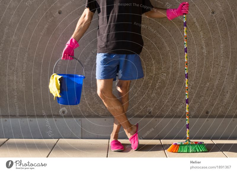 A househusband in pink slippers and cleaning utensils Summer Masculine Man Adults Body 1 Human being 30 - 45 years Wall (barrier) Wall (building) Slippers Broom