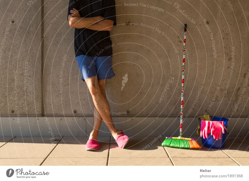A househusband in pink slippers and cleaning utensils Summer Masculine Man Adults Body 1 Human being 30 - 45 years Wall (barrier) Wall (building) T-shirt