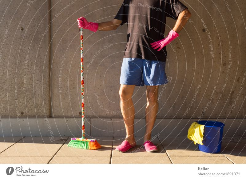 A househusband in pink slippers and cleaning utensils Summer Masculine Man Adults Partner Body 1 Human being 30 - 45 years Wall (barrier) Wall (building)