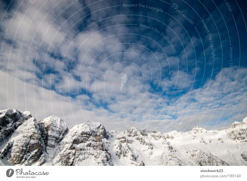 Sky Nature White Blue Vacation & Travel Clouds Winter Black Far-off places Snow Mountain Landscape Rock Large Alps Silver
