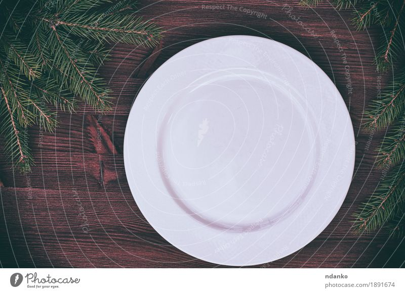 White empty plate with a green branch of spruce Christmas & Advent Tree Dish Wood Above Retro Table Kitchen New Year's Eve Crockery Plate Dinner Meal Pine