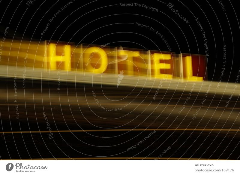 Hotel in motion Elegant Vacation & Travel Trip City trip House (Residential Structure) Facade Roof Trashy Brown Yellow Black Neon sign Colour photo
