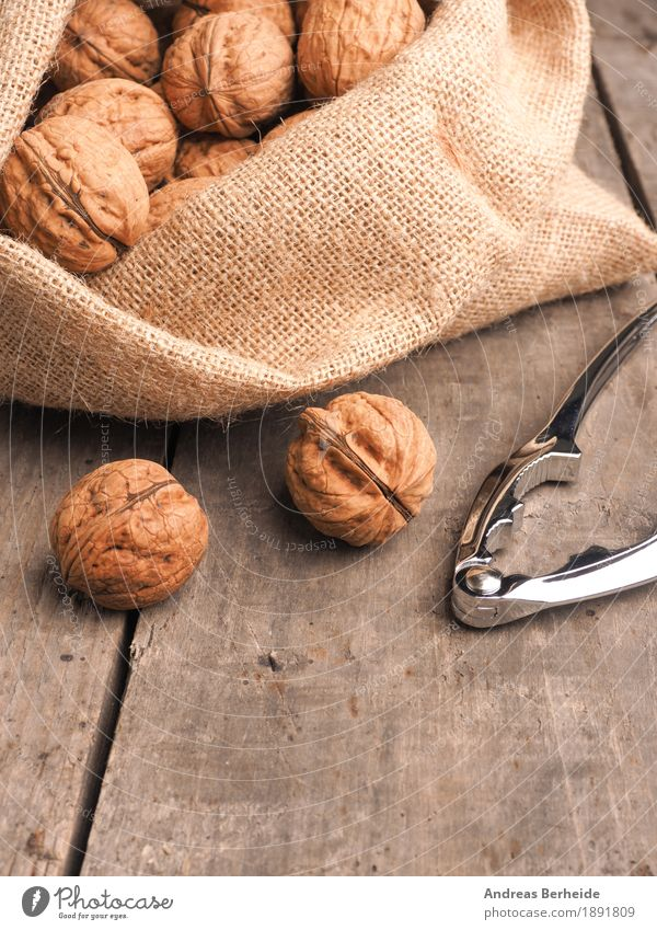 walnuts Food Fruit Nutrition Nature Sack Healthy Delicious brown Snack ingredient raw shell whole nutshell health bag tasty seasonal Walnut Wooden table Rustic