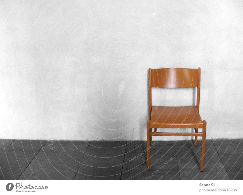 one chair Seating Wooden chair Wall (building) Living or residing Chair Sit Black & white photo