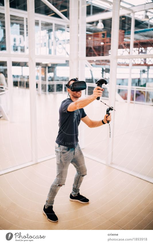Young adult men playing games with virtual reality Youth (Young adults) Man Young man Joy Adults Lifestyle Playing Leisure and hobbies Masculine Modern Technology To enjoy Future Smiling Remote Advancement