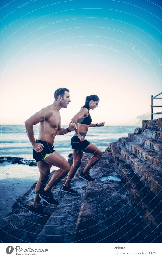 Caucasian fit couple doing running workout outdoor Human being Youth (Young adults) Blue Young woman Young man Beach 18 - 30 years Adults Lifestyle Sports Couple Waves Fitness Athletic Relationship Sports Training