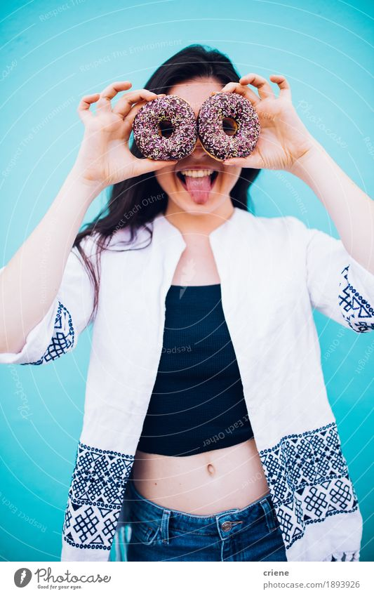 Girl holding chocolate donuts in front of her face Human being Woman Youth (Young adults) Colour Young woman Joy 18 - 30 years Adults Eating Funny Lifestyle Food Crazy Happiness Smiling Delicious