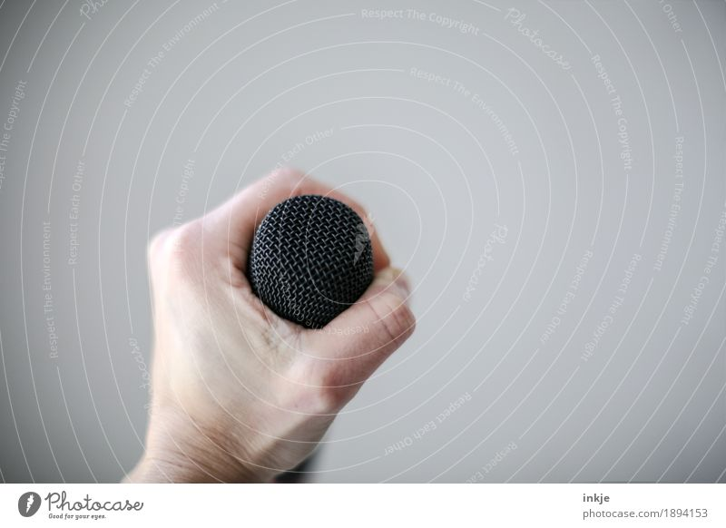 Hold on to your music. Lifestyle Hand Music Singer Microphone To hold on Emotions Resolve Creativity Bright background Shows Singing lesson Song Colour photo