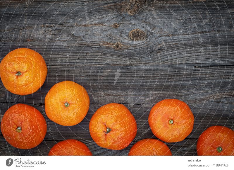 Ripe orange mandarins on the gray wooden background Fruit Dessert Eating Vegetarian diet Diet Table Group Nature Autumn Wood Old Fresh Large Natural Juicy Gray