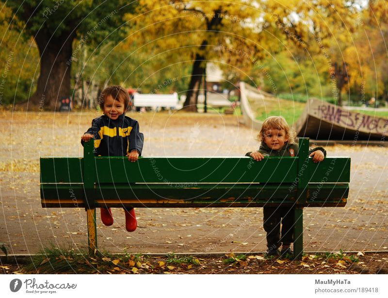Two children Human being Child Boy (child) Friendship Life 2 3 - 8 years Infancy Plant Autumn Tree Garden Park Playing Brown Yellow Green Red Colour photo Day