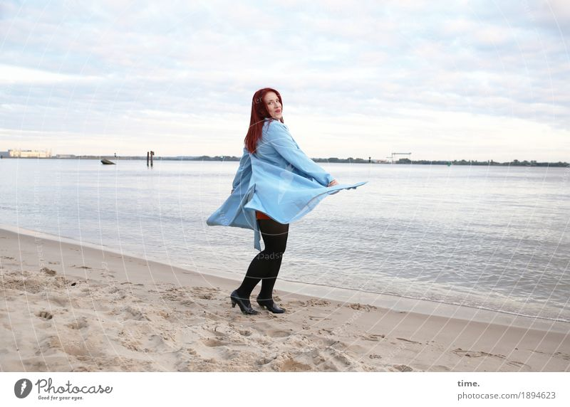 . Feminine Woman Adults 1 Human being Sky Clouds Horizon Beautiful weather Coast River bank Beach Coat Red-haired Long-haired Observe Movement Rotate Smiling