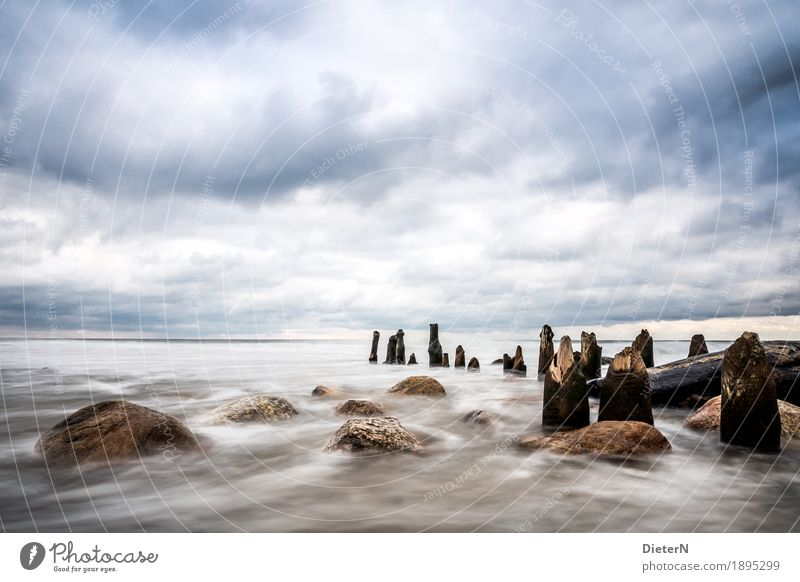 vastness Environment Nature Landscape Water Sky Clouds Beautiful weather Wind Waves Coast Baltic Sea Blue Brown White Break water Stone Rock Wood Horizon