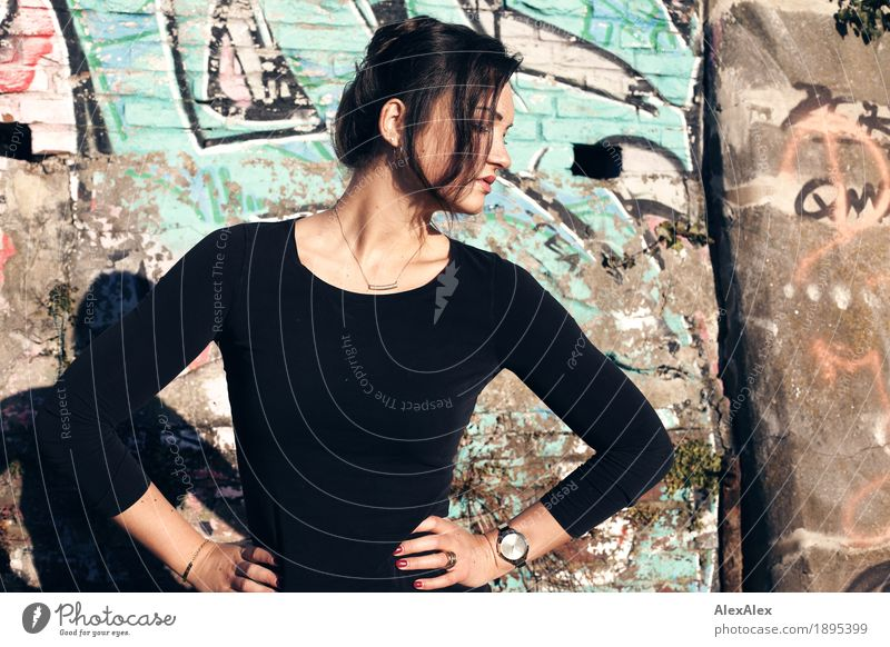 model Lifestyle Elegant Style Young woman Youth (Young adults) 18 - 30 years Adults Beautiful weather Wall (barrier) Graffiti Top Brunette Long-haired Concrete