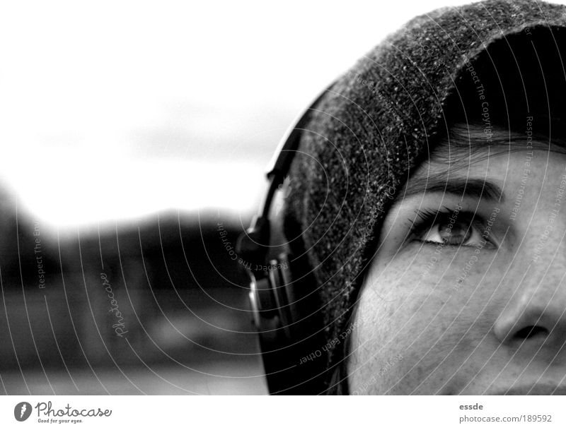 There's music in there. MP3 player Headphones Feminine Young woman Youth (Young adults) Eyes Nose 18 - 30 years Adults Nature Winter Cap Observe Think